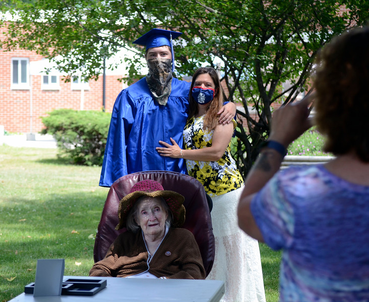 David LaChance — Bennington Banner<br /> 2020 Mount Anthony Union High School graduate Patrick Watson and his mother, Candy Shores, hug while having heir photo taken with Shores' great-grandmother, Ethyl Bourn, at the Vermont Veterans' Home in Bennington on Sunday.