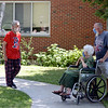 David LaChance — Bennington Banner<br /> Vermont Veterans' Home resident Mike Borden greets his mother, Terese Borden, and brother Kevin Borden on the grounds of the home on Sunday.