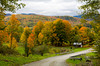 Fall foilage and road through rural, Vermont, USA.