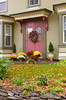 Village home in rural Vermont north of Stowe with fall foliage decor and wreathes on the front door.