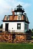 In 1909 a German immigrant named August Lorenz became Keeper of the light and remained for 22 years. Mr. Lorenz had been assigned to a light near New York City, but he began a correspondence with the Keeper of Colchester Reef and proposed switching their assignments. The New York Keeper agreed and when the Lighthouse Service assented to the switch, they agreed to meet halfway and exchange keys to their respective stations. Mr. Lorenz loved living at the light and frugally saved his money. He spread his deposits to 3 different banks so no one would know how much money he had. Eventually Lorenz reached the mandatory retirement age of 70 and was forced to retire from the life he loved in 1931. Two years later the light was decommissioned and boarded up as a pole light took its place.