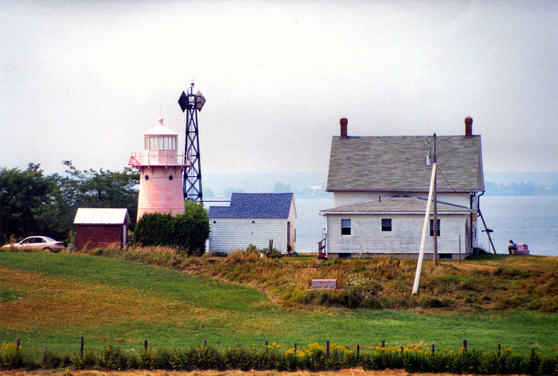 In 2001 the Coast Guard approached the Clark family about returning the navigational aid back to the lighthouse tower rather than repairing the old skeleton tower.  The Clarks readily accepted the offer and set about refurbishing the old tower which had faded to a 'Nantucket Red' hue.  A new 300mm modern optic was installed in the lantern and on October 5, 2002 in a ceremony attended by 300 well wishers the tower was reactivated as an aid to navigation.