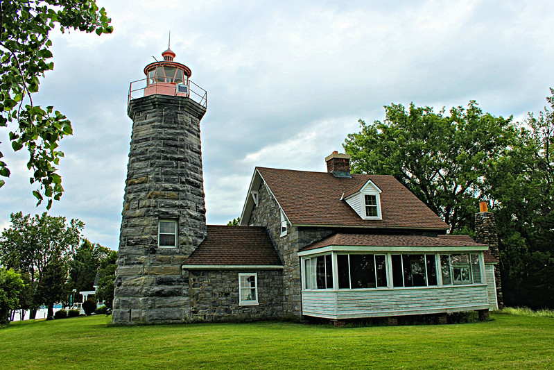 In 1931 as a cost saving measure, the Lighthouse Service decided to erect an automated 66 foot steel skeletal tower with a white acetylene tank house at Windmill Point to replace the lighthouse tower.  The lighthouse property was transferred to the U.S. Customs Service who used the dwelling as a base for fighting rum runners during Prohibition.  The lighthouse was eventually sold at public auction.