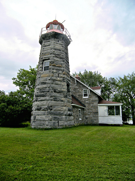 Although an 1838 U.S. Navy report recommended a lighthouse and dwelling be built at Windmill Point, it took until 1854 for Congress to appropriate $8,000 for the project.  It took another three years for the federal government to get clear title to the proposed building spot in 1857.
