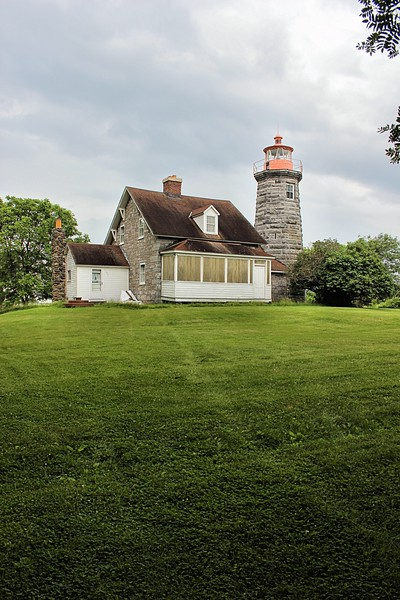 """In 1963 a local man named Lockwood """"Lucky"""" Clark was showing his fiancé around the area when he ran into the owner of the Windmill Point Lighthouse.  Lucky's father owned the nearby Isle La Motte Lighthouse, and Lucky inquired about purchasing Windmill Point.  Soon thereafter Lucky purchased the second lighthouse in his family."""