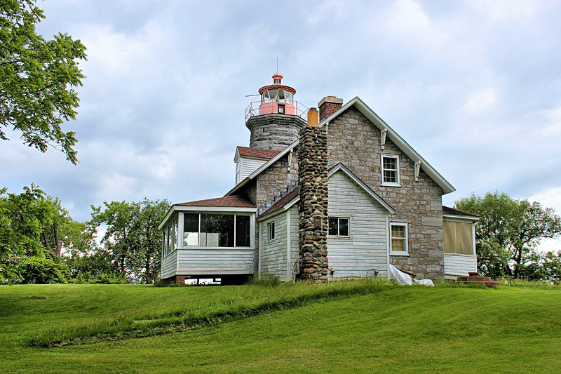 In 2001 representatives from the Coast Guard inquired about returning the light from the skeletal tower back into the lantern of the lighthouse.  Lucky and his son Ron loved the idea and worked on restoring the old tower.  On National Lighthouse Day August 7, 2002 the Windmill Point Lighthouse was re-lit as an aid to navigation.  Lucky Clark subsequently passed away in 2009 at the age of 92.