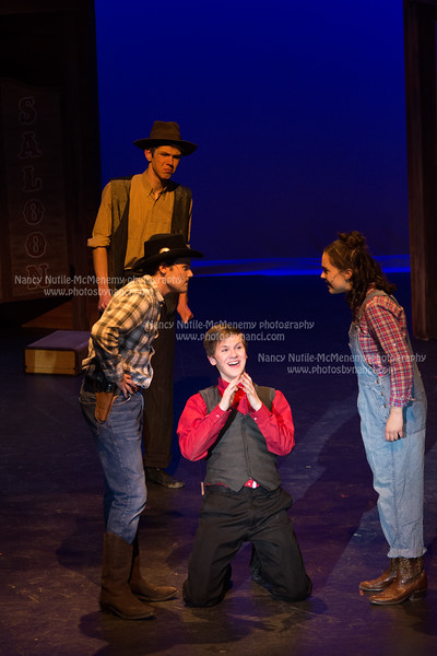 Bobby (Tommy Page, center) arrives in Deadrock and witnesses an argument between saloon owner Lank Hawkins (AJ DeFelice, left) and the only woman left in town Polly Baker (Romaney Granizo-Mackenzie, right). Polly's father, the theatre owner, Everett (Calvin McCory) listens in the background. Nancy Nutile-McMenemy photo.