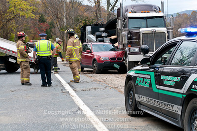 Rte 106 AccidentCar hits parked Logging Truck