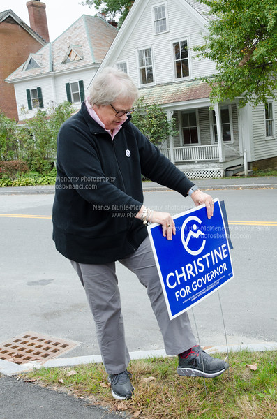 North Pomfret resident and former Vermont Democratic Party Chair Dottie Deans puts out a sign for Christine Hallquist who is the democrats candidate for governor of Vermont. Nancy Nutile-McMenemy photograph.