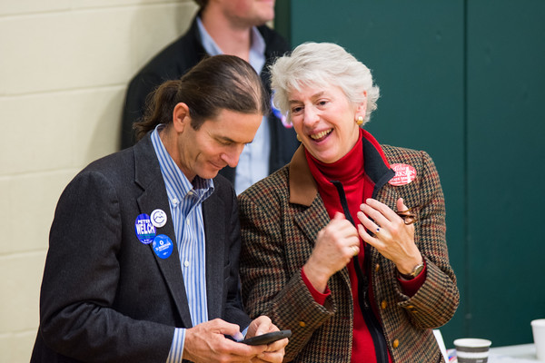 Lieutenant governor  David Zuckerman checks his phone while listening to Woodstock resident and Windsor County State Senator Alison Clarkson. Nancy Nutile-McMenemy photograph.