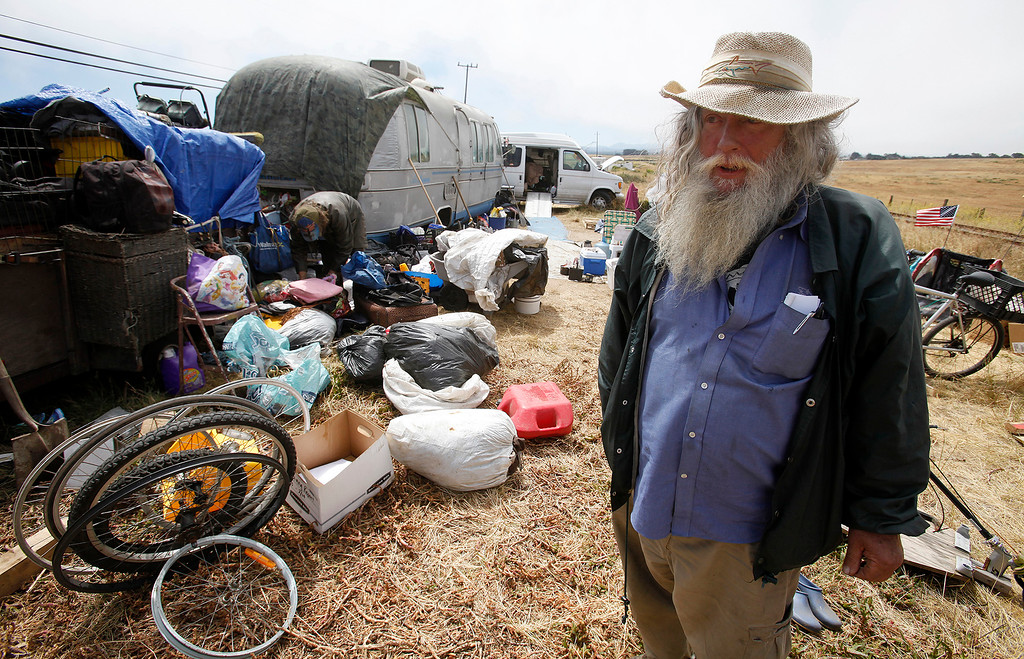 . Van Gresham stands next to his belongings on Monday, May 22, 2017 in the area that he lives in his RV on Lapis Road in a unincorporated area of Monterey County north of Marina.  (Vern Fisher - Monterey Herald)