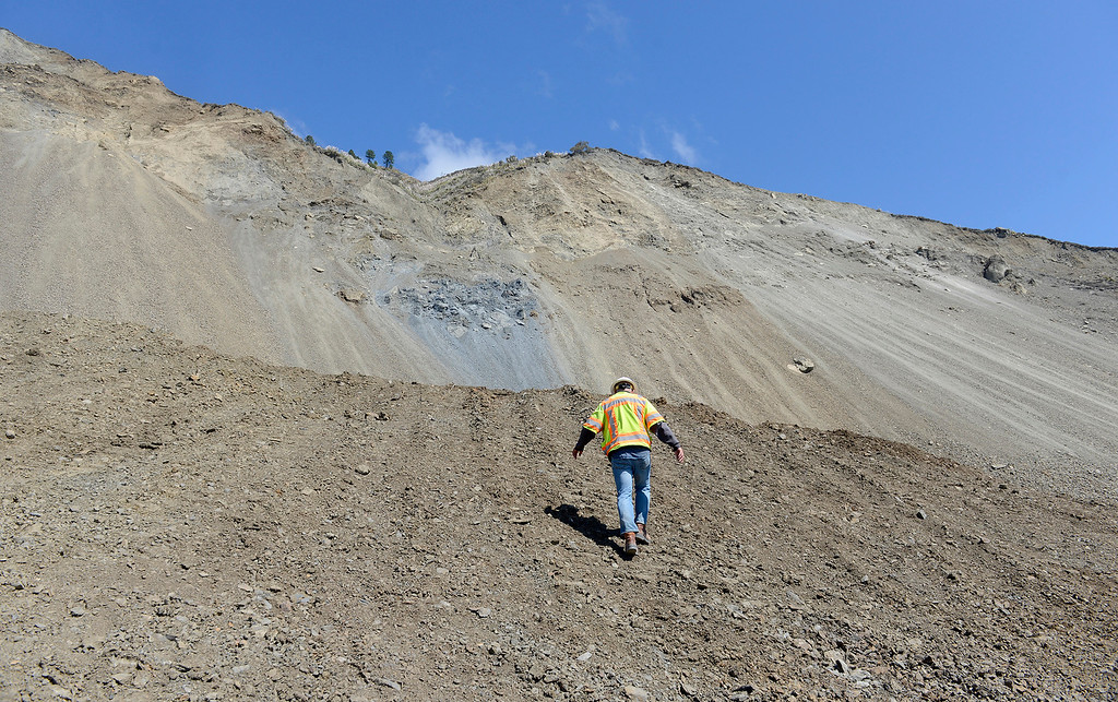 . Cal Trans engineer Wayne Walker climbs a section of the Mud Creek Slide in southern Monterey County on Highway One on Thursday, Sept. 21, 2017.   (Vern Fisher - Monterey Herald)
