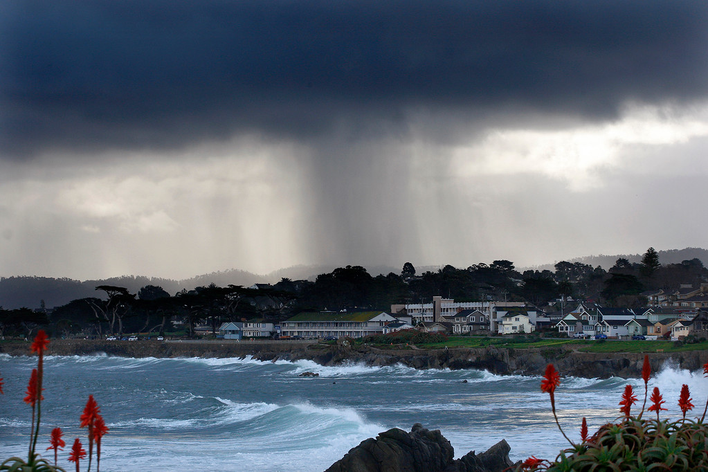 . A microburst over Monterey seen from Pacific Grove on Monday, Jan. 23, 2017.  (Vern Fisher - Monterey Herald)