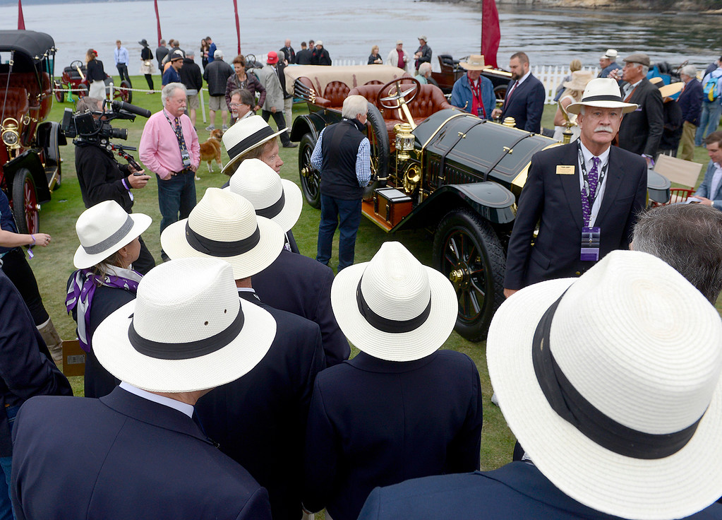 . Judges gather around a 1910 Thomas Flyer Model K 6-70 Flyabout while on display at the Pebble Beach Golf Links during the Pebble Beach Concours d\'Elegance on Sunday, Aug. 20, 2017.  (Vern Fisher - Monterey Herald)