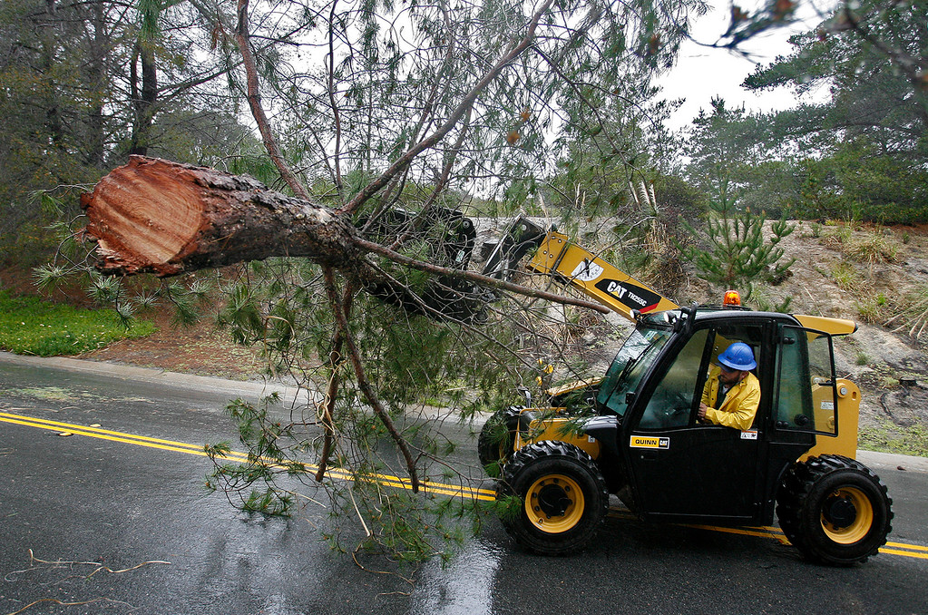 . Crews work to remove downed trees on Boots Rd. off Highway 68 on Friday, Feb. 17, 2017.  (Vern Fisher - Monterey Herald)