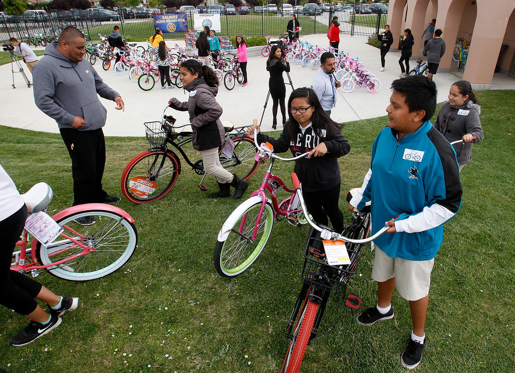 . Students with their new bikes at Monte Bella Elementary School in Salinas on Monday, June 12, 2017.  Students with 100% attendance received new bikes from the Salinas Police Department and the Alisal Rotary.  (Vern Fisher - Monterey Herald)