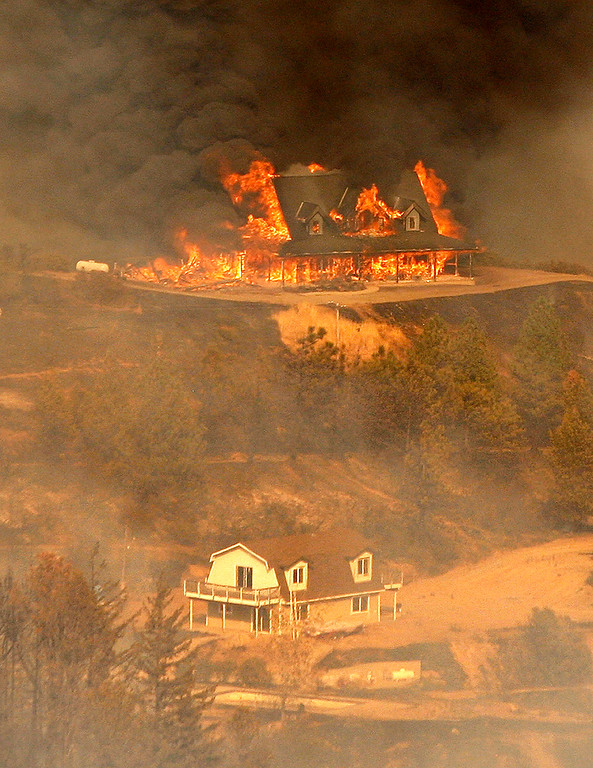 . A structure burns at the 500 acre Loma Fire burning off Loma Prieta Rd and Loma Chiquita Rd in Santa Clara County  on Monday, Sept. 26, 2016.  (Vern Fisher - Monterey Herald)