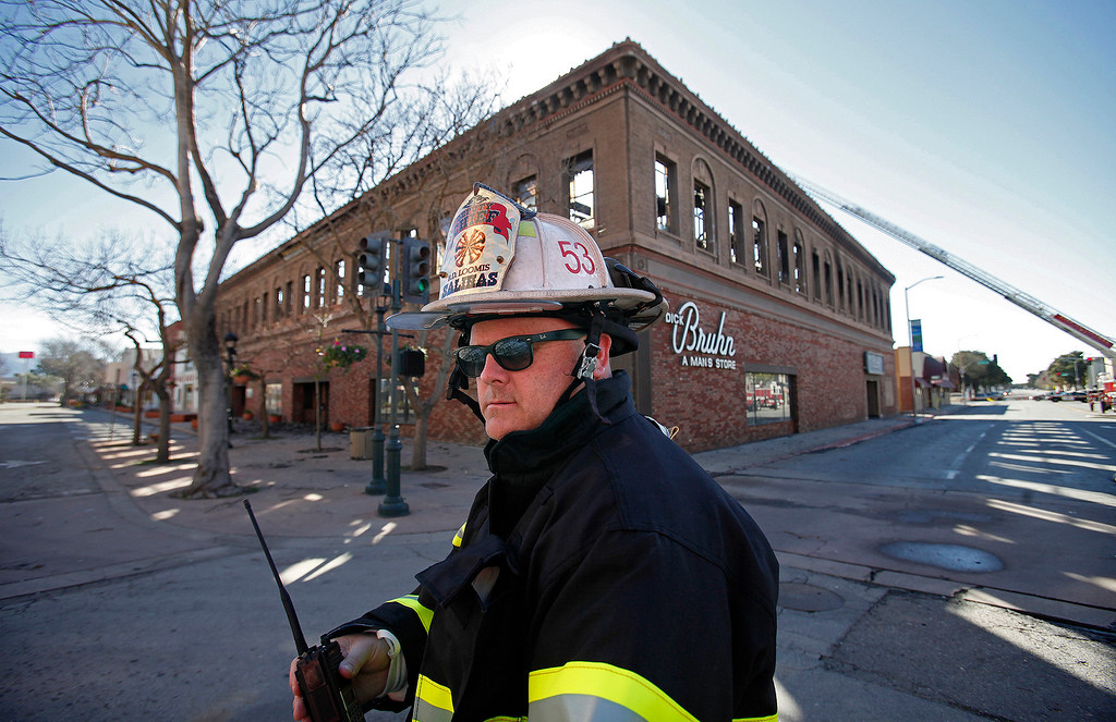 . Salinas deputy fire chief Brett Loomis on scene of the Dick Bruhn building fire on Main Street in Salinas on February 15, 2016.   (Vern Fisher - Monterey Herald)