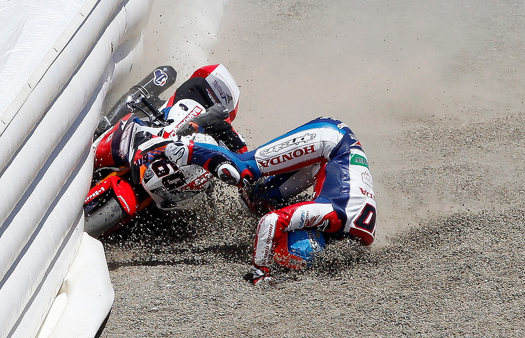 . Michael van der Mark (60) crashes in the padded wall at the corkscrew during race 2 of the FIM Superbike World Championship at Mazda Raceway Laguna Seca on Sunday, July 10, 2016.  (Vern Fisher - Monterey Herald)