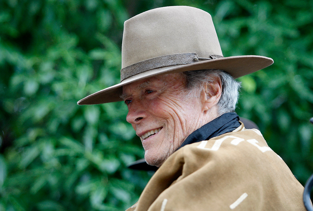 . Former Carmel mayor Clint Eastwood was the Grand Marshal and rode on a Wells Fargo stagecoach during the Carmel-by-the-Sea centennial parade on Saturday, Oct. 29, 2016.   (Vern Fisher - Monterey Herald)