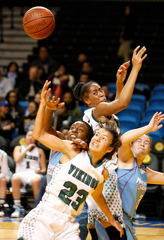 . North Salinas\' Sherise Robinson (22) and Alyssa Foster (33) battle against Palo Alto\'s Coco Lovely (23) and Alexis Harris (24) during their Central Coast Section Division 1 Championship game at the Kaiser Permanente Arena in Santa Cruz on Saturday, March 5, 2016.  Palo Alto High beat North Salinas High 59-44 for the D1 championship.  (Vern Fisher - Monterey Herald)