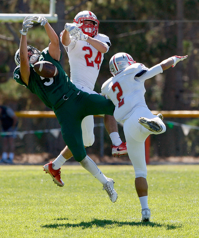 . Stevenson\'s Brody Flagg (5) misses a pass against two Carmel defenders durng their game in Pebble Beach against Carmel High on Saturday, Sept. 24, 2016.  (Vern Fisher - Monterey Herald)