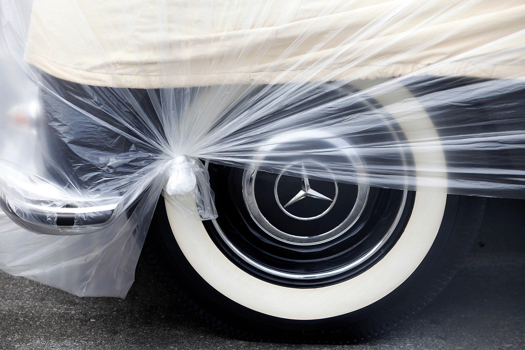 . A Mercedes is wrapped in plastic as it arrives in Monterey on Monday, August 15, 2016.  The vehicles participating in the Russo and Steele auction were arriving and stored in the Fisherman\'s Wharf parking.   (Vern Fisher - Monterey Herald)