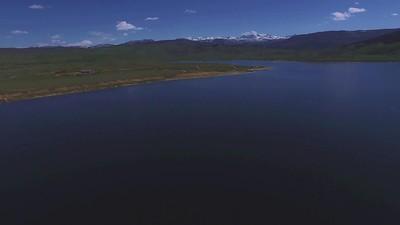 5-Majestic snow-capped peaks behind fisherman on Soda Lake