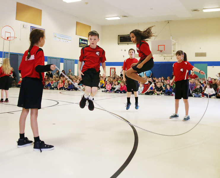 HOLLY PELCZYNSKI - BENNINGTON BANNER Students from Vernon Elementary School visit Pownal Elementary School to show off some of their tricks. Above Bowen Emery and Naima Harris caught suspended in air while jumping rope together in unison.