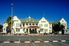 Namibia, Windhoek<br /> Winshoek railway station built in 1912 in German colonial style, a mixture of Art Nouveau and imperial baroque revival. In the front of the building a locomotive of the narrow gauge railway is exhibited.