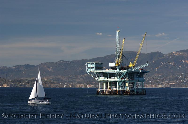 "Sailing vessel and Platform ""C,"" Santa Barbara Channel - Santa Barbara coasline in back."