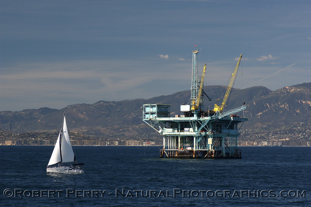 "Sailing vessel and Platform ""C,"" Santa Barbara Channel - Santa Barbara coasline in back."