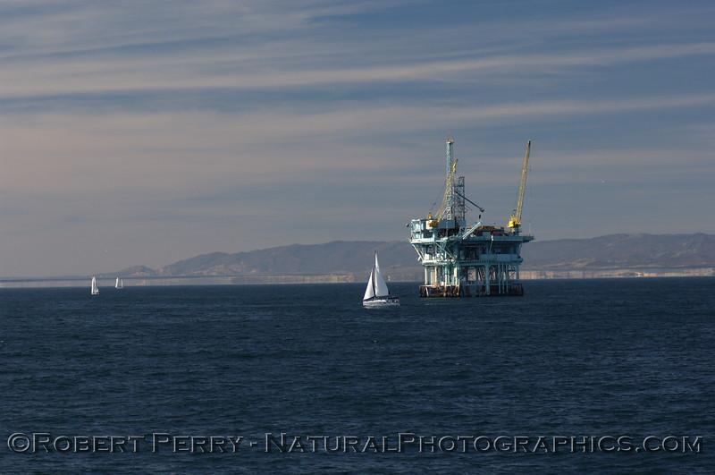 "Sailing vessels and Platform ""C,"" Santa Barbara Channel - Santa Barbara coasline in back.  Far view."