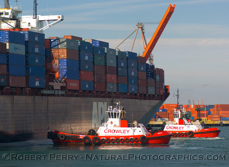 Crowley tugs Admiral and Master bring the container vessel APL Sweden to berth.