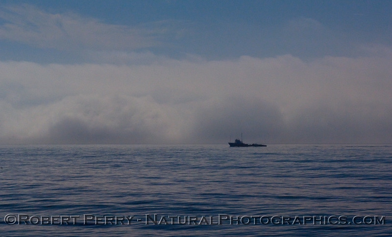Fog approaching an oil rig crew and supply boat.