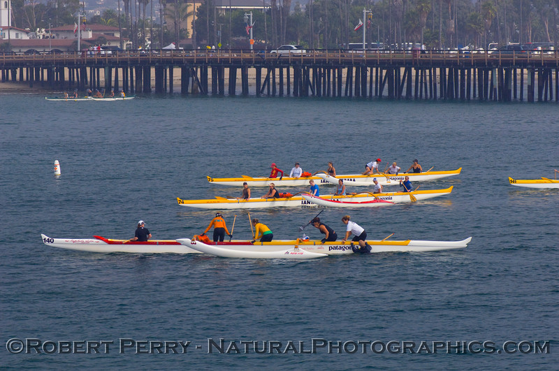 Outrigger canoes in Santa Barbara Harbor; Stern's Wharf is visible in the background.