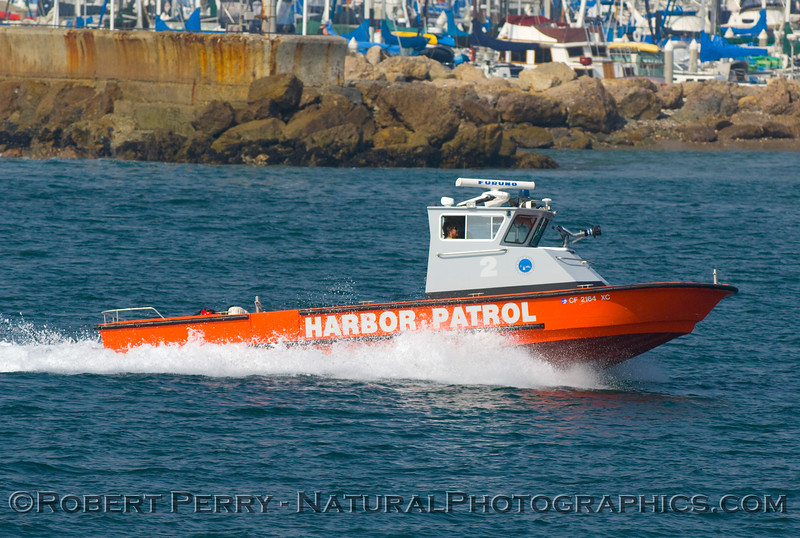 Santa Barbara Harbor Patrol vessel rounding the breakwater and preparing to re-enter the Harbor.