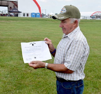 Vietnam Veteran Bill Haack of Hidalgo holds a copy of the The Army Commendation Medal he received for his service in Vietnam from 1965-66. Haack was a U.S. Army Specialist Four in the First Air Cavalry. Charles Mills photo