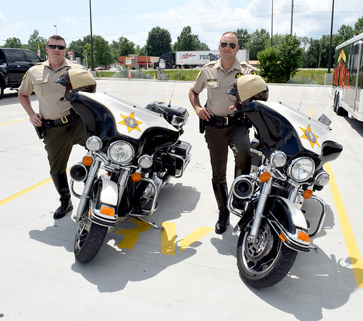 Illinois State Police District 12 Motorcycle Patrol members Seth Williams, left and Josh Fergus, right, led a group of approximately 50 motorcycles escorting the American Veterans Traveling Tribute Vietnam Wall from Greenup to Effingham on Wednesday afternoon. Charles Mills photo