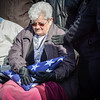 """Emily Morrissette, also known as """"Duckie"""" who is the wife of Veteran Zenon Morrissette, clutches the American Flag that was given to her during the funeral ceremony in Tyngsboro. SUN/Caley McGuane"""
