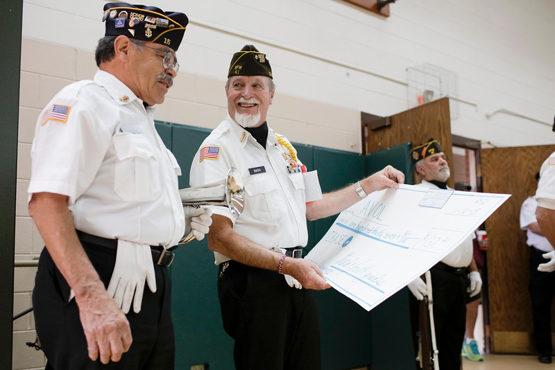 Art Terrones and Charlie Nash happily accept a check for $137.21 given to them by students of Big Thompson Elementary School on Tuesday, Nov. 10, 2015 in Loveland. The donation was a token of appreciation for veterans sacrifices. (Photo by Trevor L. Davis/Loveland Reporter-Herald)