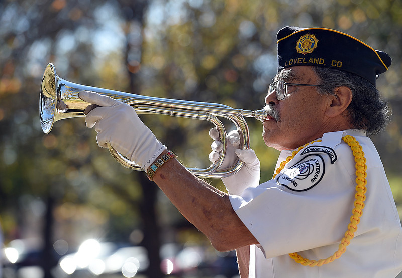 Art Terrones with the Associated Veterans of Loveland Honor Guard plays Taps on the bugle during the Veterans Day ceremony Friday, Nov. 11, 2016, at Dwayne Webster Veteran's Park in Loveland. (Photo by Jenny Sparks/Loveland Reporter-Herald)