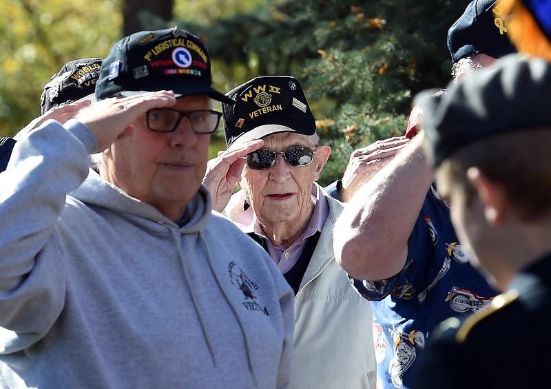 WWII Air Force veteran Mel Engeman, center, salutes during the Pledge of Allegiance at the Veterans Day Ceremony Friday, Nov. 11, 2016, at Dwayne Webster Veterans Park in Loveland. (Photo by Jenny Sparks/Loveland Reporter-Herald)