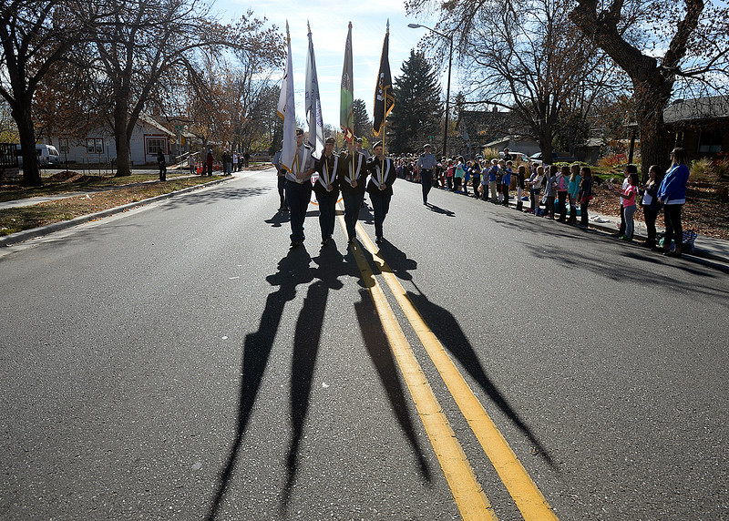 Memebers of the Berthoud High JROTC march during the Veterans Day parade Friday, Nov. 11, 2016, in Loveland. (Photo by Jenny Sparks/Loveland Reporter-Herald)
