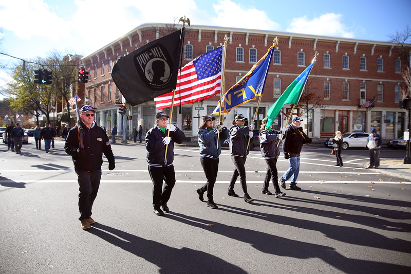 HOLLY PELCZYNSKI - BENNINGTON BANNER Veterans with the VFW walk ithrough the four corners of Bennington during The Veterans Day parade on Sunday morning.