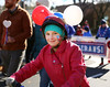 HOLLY PELCZYNSKI - BENNINGTON BANNER Khloe Roberts - Cordeau 9 years old of North Bennington is decked in red, white, and blue balloons and a flag face painting while riding her bicycle in the Veterans Day parade on Sunday in Bennington.