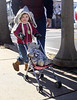 HOLLY PELCZYNSKI - BENNINGTON BANNER Alice Foster, 2 years old of Shaftsbury pushes her teddy bear decked in camouflage and dog tags on Sunday during the Veterans Day Parade in Bennington.