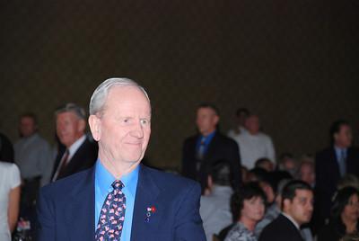 Jerry Molen (USMC) stands during the Service Medley