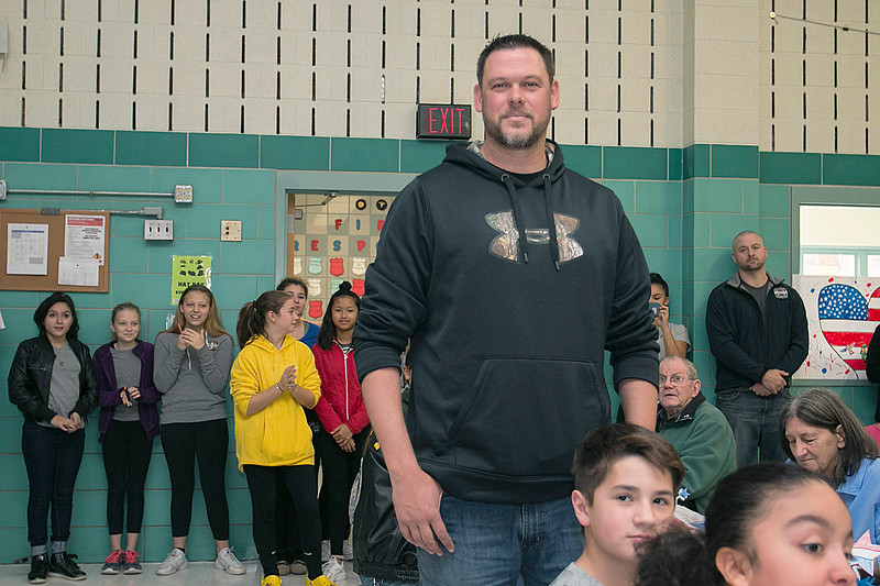Navy veteran Corpman Jeff LeMay stands as the Samoset Middle School Choir sang the Navy Hymn section of the Armed Force Medley during the veterans lunch on Thursday at the school. SENTINEL & ENTERPRISE/JOHN LOVE