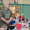 Marine veteran Lance Corporal Todd Deacon stands as the Samoset Middle School Choir sang the Marine's Hymn section of the Armed Force Medley during the veterans lunch on Thursday at the school. SENTINEL & ENTERPRISE/JOHN LOVE
